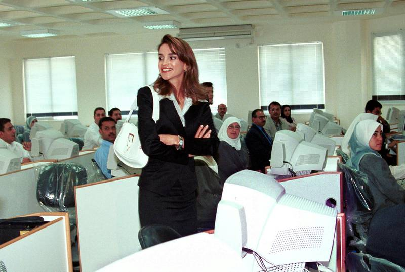 """390250 01: Queen Rania of Jordan visits the """"Queen Rania Centre for Education Technology"""" that she opened June 6, 2001 in Amman, Jordan. The Centre is one of thirty to be opened in different cities of Jordan for school teachers. The centre has 116 computers, 50 of them are donated by Hewlett Packard. (Photo by Salah Malkawi/Getty Images)"""