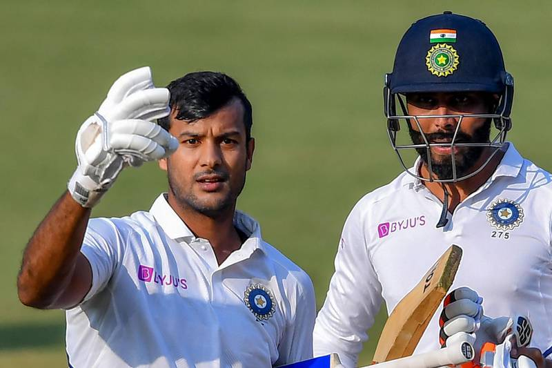 India's Mayank Agarwal (L) flashes two fingers after scoring a double-century (200 runs) as teammate Ravindra Jadeja looks on during the second day of the first Test cricket match of a two-match series between India and Bangladesh at Holkar Cricket Stadium in Indore on November 15, 2019.  - ----IMAGE RESTRICTED TO EDITORIAL USE - STRICTLY NO COMMERCIAL USE----- / GETTYOUT  / AFP / Indranil MUKHERJEE / ----IMAGE RESTRICTED TO EDITORIAL USE - STRICTLY NO COMMERCIAL USE----- / GETTYOUT