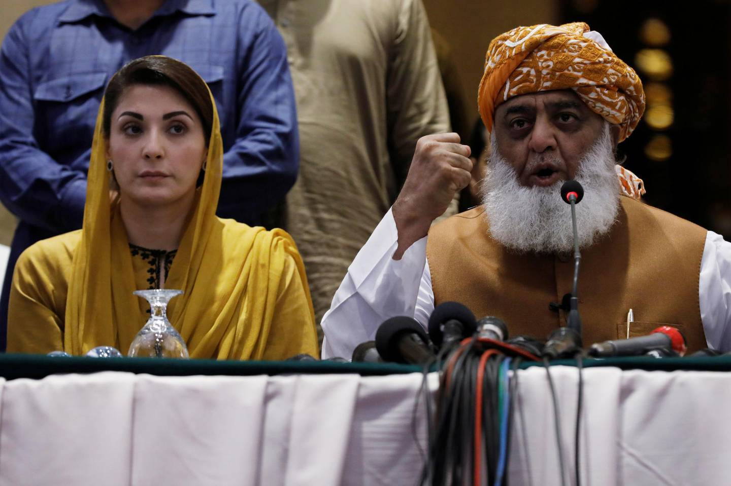 Fazal-ur Rehman, of the Jamiat Ulema-e-Islam-Fazal (JUI-F) and president of the Pakistan Democratic Movement (PDM), an alliance of political opposition parties, along with Maryam Nawaz, the daughter of Pakistan's former Prime Minister Nawaz Sharif address a news conference in Karachi, Pakistan October 19, 2020. REUTERS/Akhtar Soomro