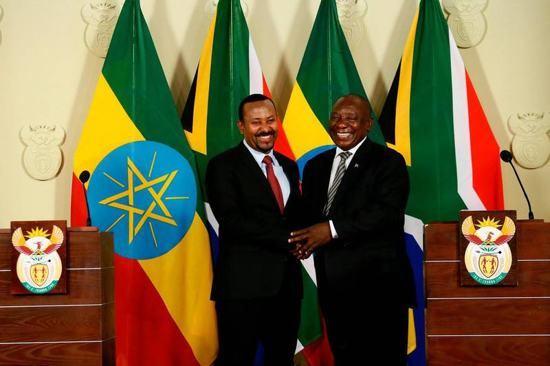 South African President Cyril Ramaphosa (R) and Prime Minister of Ethiopia Abiy Ahmed Ali (L) shake hands after concluding a press conference at the Union Buildings in Pretoria on January 12, 2020, following their meeting on matters of mutual national development, regional and continental issues as well as international developments.  / AFP / Phill Magakoe