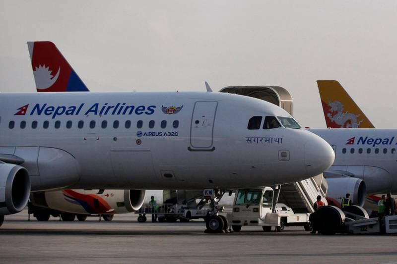 Nepal Airlines Airbus 320 and other international airlines are seen parked inside Tribhuwan International airport in Kathmandu, Nepal, Monday, Nov. 9, 2015. Airlines in Nepal have been forced to cancel more than half of their domestic flights because of an ongoing fuel shortage, an official said Monday. (AP Photo/Niranjan Shrestha)