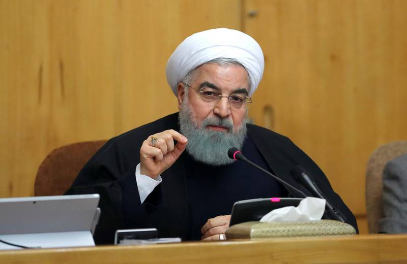 """In this photo released by official website of the office of the Iranian Presidency, President Hassan Rouhani speaks in a cabinet meeting in Tehran, Iran, Sunday, Dec. 31, 2017. After a wave of economic protests swept major cities in Iran, President Rouhnai said Sunday that people have the right to protest, but those demonstrations should not make the public """"feel concerned about their lives and security."""" (Iranian Presidency Office via AP)"""