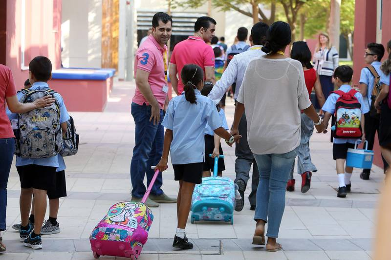 DUBAI , UNITED ARAB EMIRATES – Aug 28 , 2016 : Students coming on the first day of school after the summer vacation at the Bradenton Preparatory Academy in Dubai Sports City in Dubai. ( Pawan Singh / The National ) For News. Story by Nadeem Hanif. ID No - 77443 *** Local Caption ***  PS2808- NEW SCHOOL YEAR08.jpg