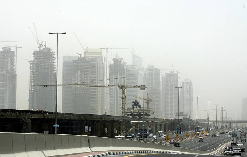 Scores of buildings under construction along the new subway line are seen on June 15, 2008 through a layer of haze as temperatures soared in the Gulf emirate of Dubai. The Gulf's booming construction industry is feeling the heat of soaring materials costs and labour shortages amid concern that supply pressures coud delay the completion of projects.    AFP PHOTO/MARWAN NAAMANI (Photo by MARWAN NAAMANI / AFP)