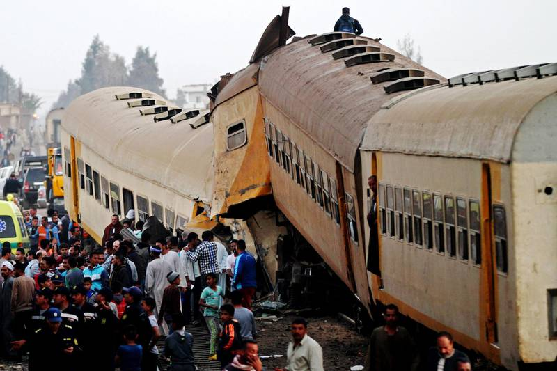 epa06570876 People inspect the wreckage of a passenger train that collided with a freight train in the village of Kom Hamada in the northern province of Beheira, Egypt, 28 February 2018. Reports state at least 15 people died and 40 injured in the accident that occurred when two passenger carriages disconnected from the rest of the train and collided with a freight train, the cause of which is still unknown.  EPA/STR