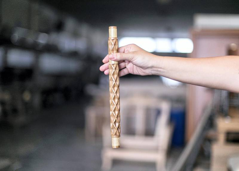 SHARJAH, UNITED ARAB EMIRATES. 7 SEPTEMBER 2019. Lana El Samman holds a sample of het table's leg, produced in Aden wood and furniture factory.Lana El Samman is currently a resident designer in Tashkeel's Tanween program. The program is open to emerging designers, makers and artisans living and working in the UAE.Lana El Samman is of Lebanese origin, and grew up in Beirut and later Canada, where she studied interior design followed by a Master's degree at the Florence Institute of Design, Italy. Her career began as a teaching assistant at the American University of Sharjah before joining Sharjah Art Foundation, which has been her home for the past eight years working as an interior designer and then progressing to become a significant member of the production programme. In the SAF Production Programme, Samman has had the chance to further her furniture design practice and create pieces used by the Foundation for various events.(Photo: Reem Mohammed/The National)Reporter: KATE HAZELLSection: WK