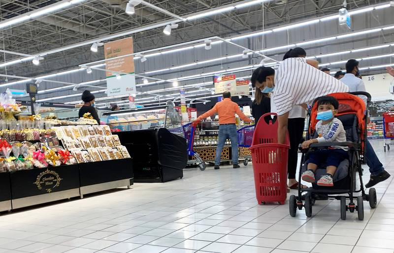 DUBAI, UNITED ARAB EMIRATES , September 13 – 2020 :- Shoppers wearing protective face mask as a preventive measure against the spread of coronavirus inside the Carrefour hypermarket at Ibn Battuta Mall in Dubai.  (Pawan Singh / The National) For News/Stock