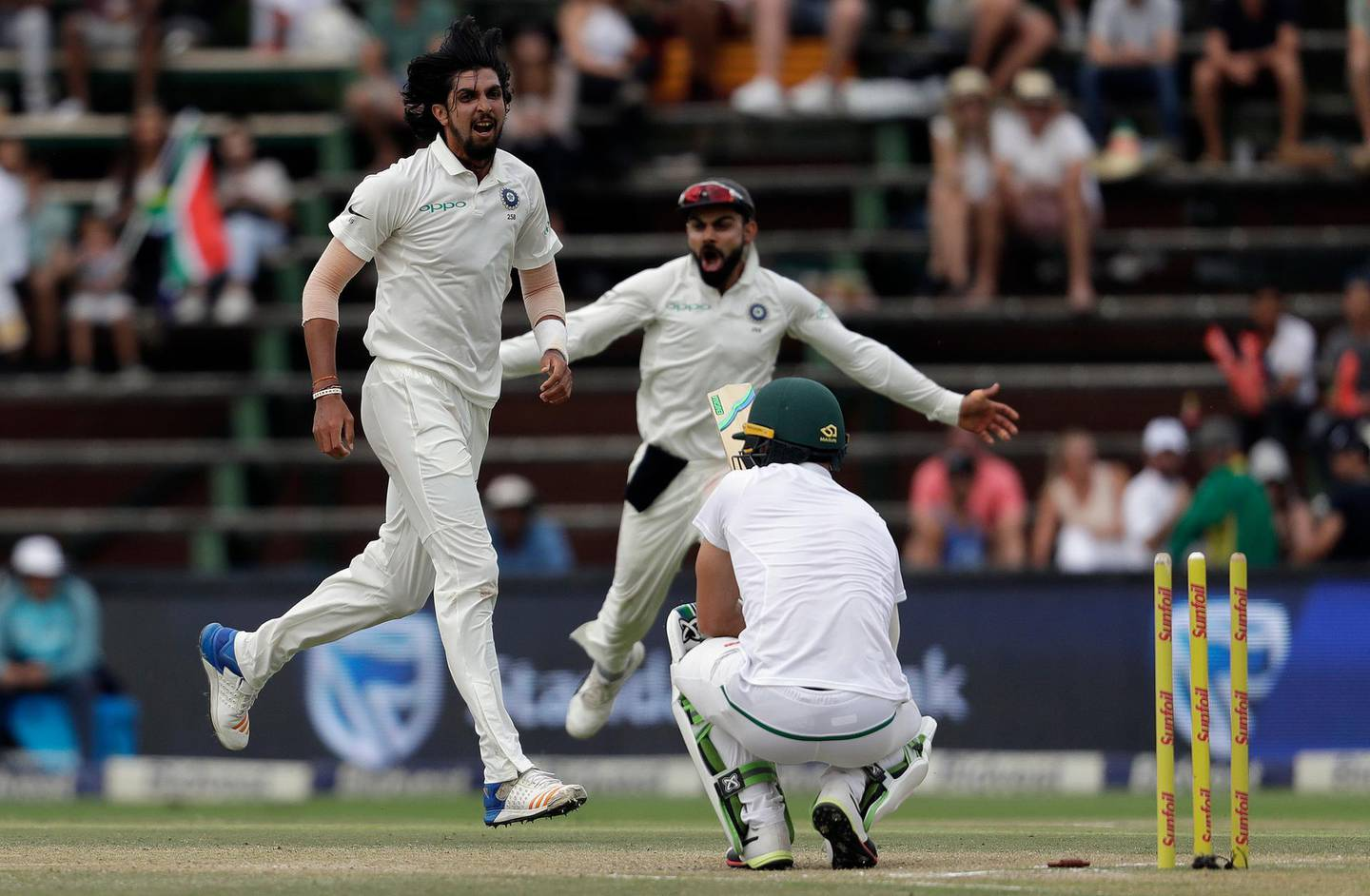 India's bowler Ishant Sharma, left, with captain Virat Kohli reacts after bowling South Africa's captain Faf du Plessis' for 2 runs on the fourth day of the third cricket test match between South Africa and India at the Wanderers Stadium in Johannesburg, South Africa, Saturday, Jan. 27, 2018. (AP Photo/Themba Hadebe)