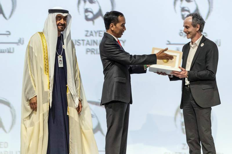ABU DHABI, UNITED ARAB EMIRATES. 13 JANUARY 2020. The Zayed Sustainability Awards held at ADNEC as part of Abu Dhabi Sustainability Week. H.E. Sheikh Mohammed bin Zayed Al Nahyan, Crown Prince of Abu Dhabi and Deputy Supreme Commander of the United Arab Emirates Armed Forces awards Energy Winner: Electricians Without Borders, France. H.E. Joko Widodo, President of the Republic of Indonesia. (Photo: Antonie Robertson/The National) Journalist: Kelly Clarker. Section: National.