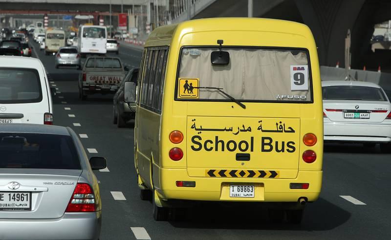 DUBAI, UNITED ARAB EMIRATES – Feb 18: School bus on Sheikh Zayed Road in Dubai. (Pawan Singh / The National) *** Local Caption ***  PS02-SCHOOL BUS.jpgOP05AP_SCHOOL BUS.jpg