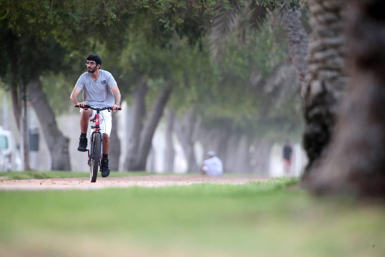Abu Dhabi, United Arab Emirates, July 10, 2015:    A man rides his bicycle along Khaleej Al Arabi street in the Al Mushrif area of Abu Dhabi on July 10, 2015. Christopher Pike / The National  Reporter:  N/A Section: News Keywords:    *** Local Caption ***  CP0710-na-Standalone01.JPG