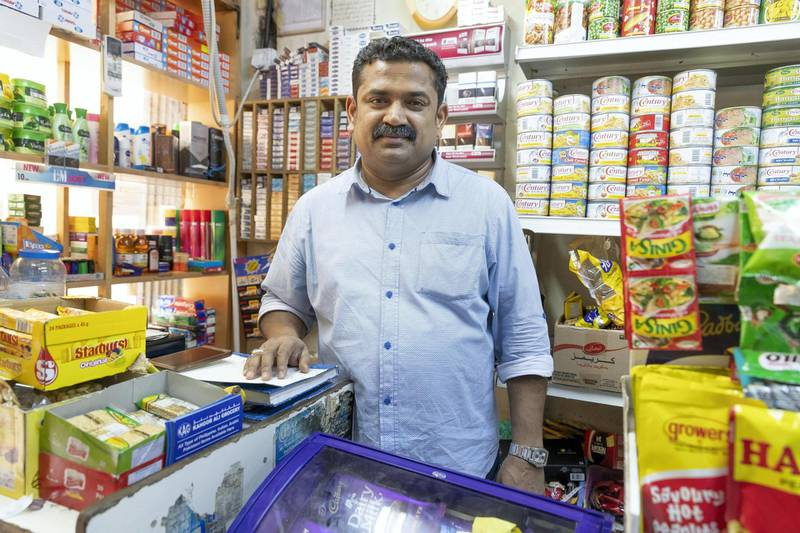 DUBAI, UNITED ARAB EMIRATES. 24 APRIL 2018. Neyas Kadankandy Mangodon comments about the social media posts showing a model posing in Satwa from  his Baqala / Grocery shop in Satwa called Kahoor Ali Grocery where the original pictures were taken. (Photo: Antonie Robertson/The National) Journalist: Anna Zacharias. Section: National.