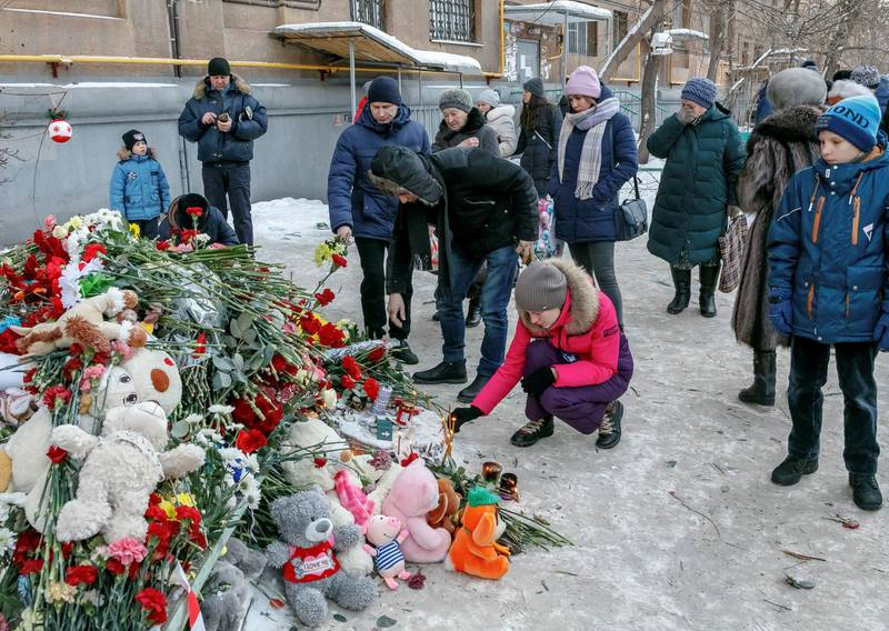 People bring flowers, candles and toys to commemorate victims of a recent explosion in an apartment block in Magnitogorsk, Russia January 2, 2019. REUTERS/Andrey Serebryakov