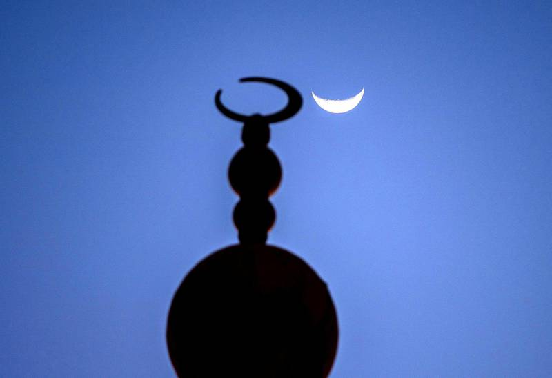 Abu Dhabi, United Arab Emirates, April 17, 2021.   The crescent moon shows itself at the Sheikh Zayed Bin Sultan Al Nahyan Mosque at Al Bahia, Abu Dhabi.Victor Besa/The NationalSection:  NA/Stand Alone/Stock Images