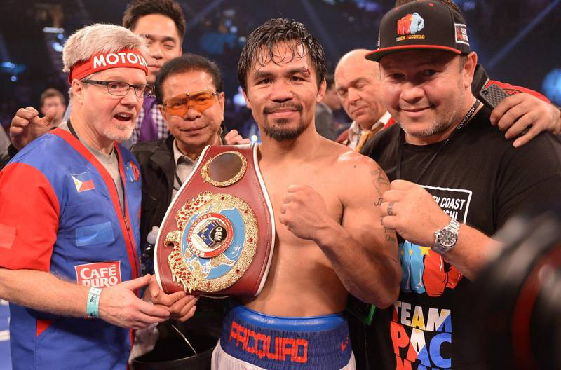 Manny Pacquiao of Philippines celebrates victory over Timothy Bradley of US  following their  WBO World Welterweight Championship title match at the MGM Grand Arena in Las Vegas, Nevada on April 12, 2014.  Pacquiao went on to wina 12-round unanimous decision over  Bradley to avenge his controversial 2012 loss to the previously unbeaten American. AFP PHOTO / JOE KLAMAR (Photo by JOE KLAMAR / AFP)