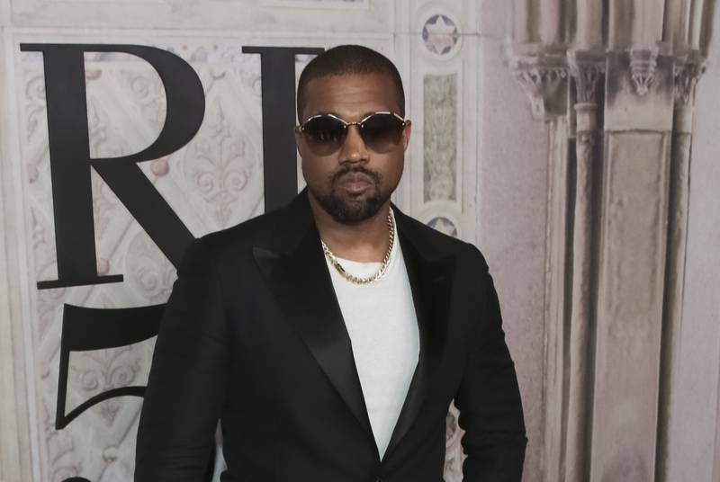 FILE - In this Sept. 7, 2018, file photo, Kanye West attends the Ralph Lauren 50th Anniversary Event held at Bethesda Terrace in Central Park during New York Fashion Week in New York. Kanye West surprised fans at a tribute honoring the late rapper XXXTentacion during Art Basel, jumping onstage to perform his brand new song with the rapper who was gunned down in Florida earlier this year on Thursday, Dec. 6, 2018. (Photo by Brent N. Clarke/Invision/AP, File)