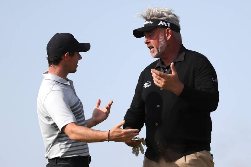 Northern Ireland's Rory McIlroy, left, and Darren Clarke, talk on the 9th hole during a practice round ahead of the British Open Golf Championship, at Royal Birkdale, Southport, England Tuesday, July 18, 2017. (AP Photo/Peter Morrison)