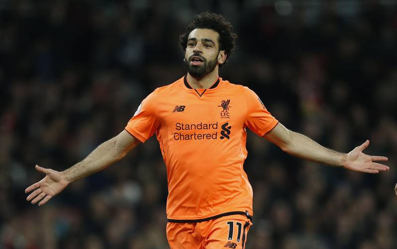 Liverpool's Egyptian midfielder Mohamed Salah  celebrates scoring the second goal during the English Premier League football match between Arsenal and Liverpool at the Emirates Stadium in London on December 22, 2017. (Photo by Ian KINGTON / AFP) / RESTRICTED TO EDITORIAL USE. No use with unauthorized audio, video, data, fixture lists, club/league logos or 'live' services. Online in-match use limited to 75 images, no video emulation. No use in betting, games or single club/league/player publications. /