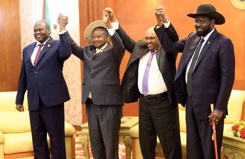 Sudan's President Omar Al-Bashir hold hands with Uganda's President Yoweri Museveni, South Sudan's President Salva Kiir and South Sudan rebel leader Riek Machar during a South Sudan peace meeting as part of talks to negotiate an end to a civil war that broke out in 2013, in Khartoum, Sudan June 25, 2018. REUTERS/Mohamed Nureldin Abdallah