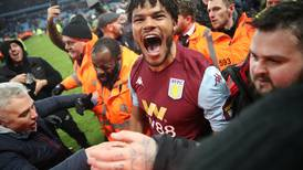 Aston Villa players and fans celebrate together on the pitch after reaching League Cup final in dramatic style - in pictures
