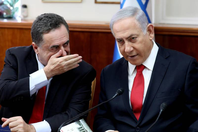FILE PHOTO: Israeli Prime Minister Benjamin Netanyahu listens to Foreign Minister Israel Katz during the weekly cabinet meeting in Jerusalem October 27, 2019. Gali Tibbon/Pool via REUTERS/File Photo