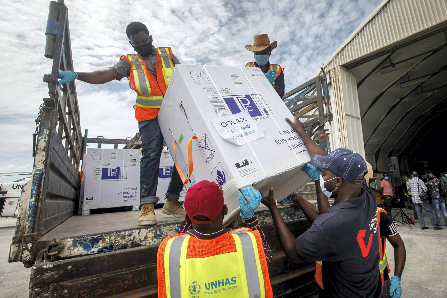 """FILE — In this March 15, 2021 file photo boxes of AstraZeneca COVID-19 vaccine manufactured by the Serum Institute of India and provided through the global COVAX initiative arrive at the airport in Mogadishu, Somalia. Africa is """"watching with total disbelief"""" as India struggles with a devastating resurgence in COVID-19 cases, the continent's top public health official said Thursday, April 29, 2021, as African officials worry about delays in vaccine deliveries caused by India's crisis.  (AP Photo/Farah Abdi Warsameh/File)"""