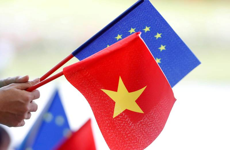 FILE PHOTO: FILE PHOTO: European Union and Vietnamese flags are seen at the signing ceremony of EU-Vietnam Free Trade Agreement at the government office in Hanoi, Vietnam June 30, 2019. REUTERS/Kham/File Photo