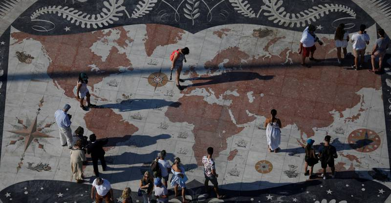 People take pictures at a square decorated with a giant world map in Lisbon, Portugal September 6, 2017. REUTERS/Rafael Marchante