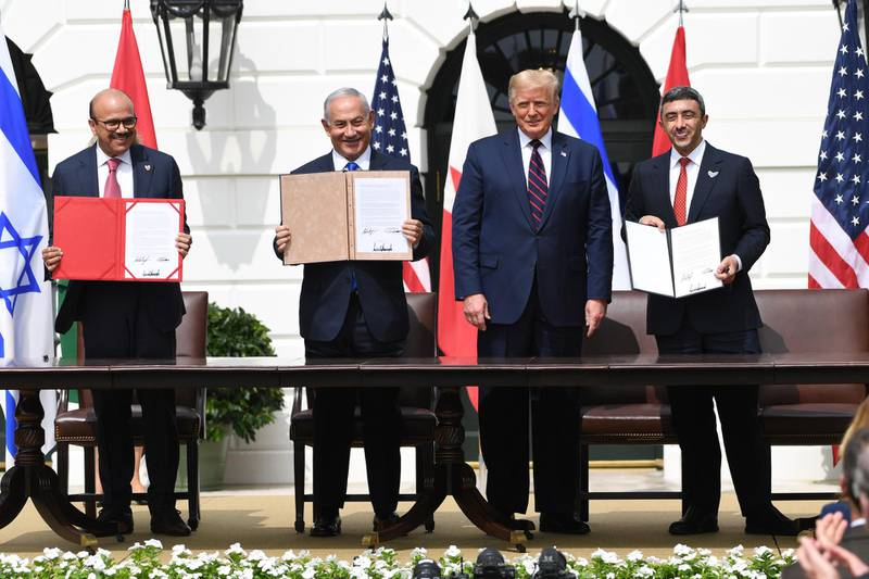 (L-R)Bahrain Foreign Minister Abdullatif al-Zayani, Israeli Prime Minister Benjamin Netanyahu, US President Donald Trump, and UAE Foreign Minister Abdullah bin Zayed Al-Nahyan participate in the signing of the Abraham Accords where the countries of Bahrain and the United Arab Emirates recognize Israel, at the White House in Washington, DC, September 15, 2020. - Israeli Prime Minister Benjamin Netanyahu and the foreign ministers of Bahrain and the United Arab Emirates arrived September 15, 2020 at the White House to sign historic accords normalizing ties between the Jewish and Arab states. (Photo by SAUL LOEB / AFP)
