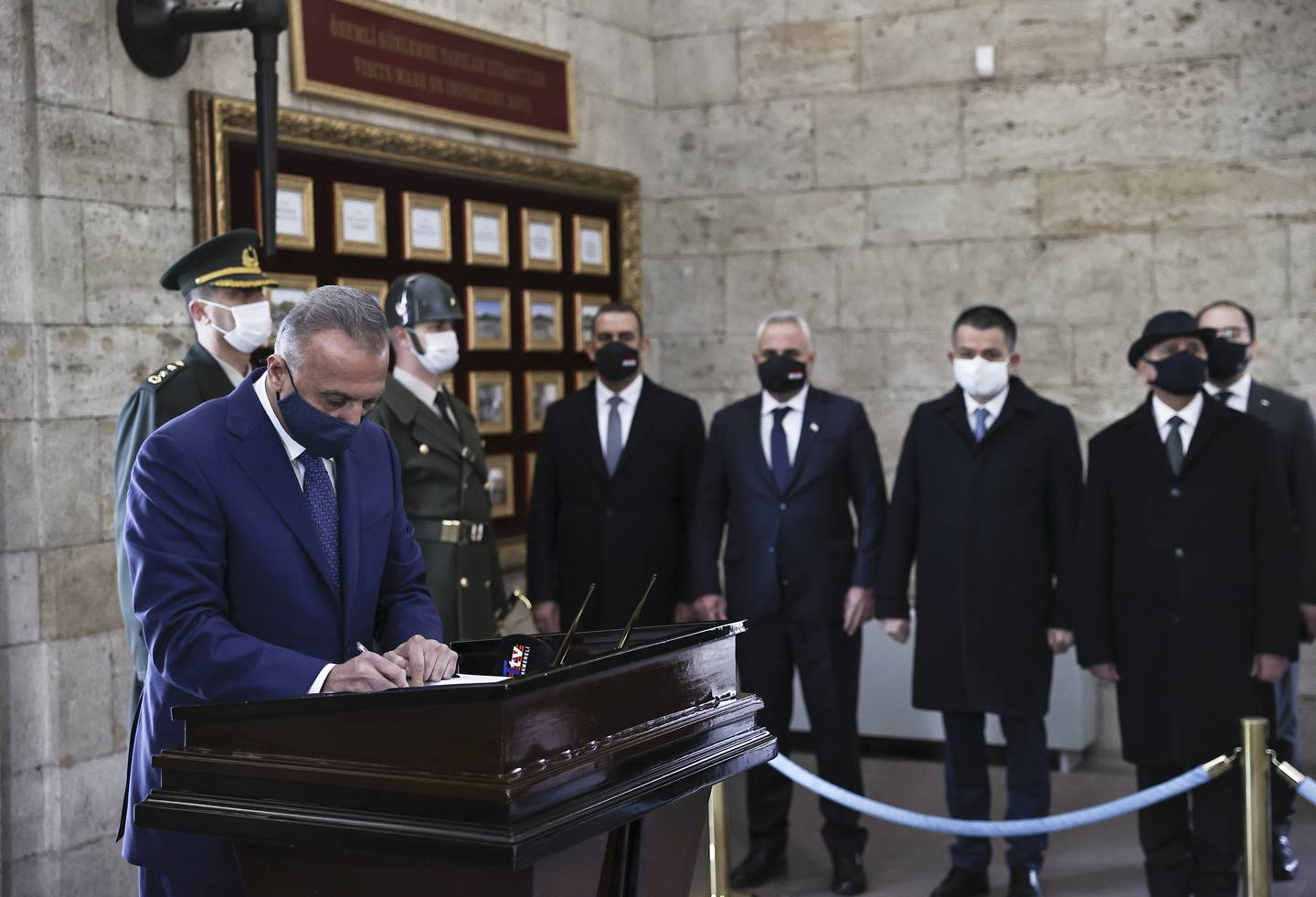 ANKARA,TURKEY - DECEMBER 17: Iraqi Prime Minister Mustafa Al-Kadhimi signs guest book during his visit to Anitkabir, the mausoleum of the founder of Turkish Republic Mustafa Kemal Ataturk, in Ankara, Turkey on December 17, 2020. Iraqi Prime Minister accompanied by Minister of Agriculture and Forestry of Turkey, Bekir Pakdemirli during his visit. (Photo by Emin Sansar/Anadolu Agency via Getty Images)