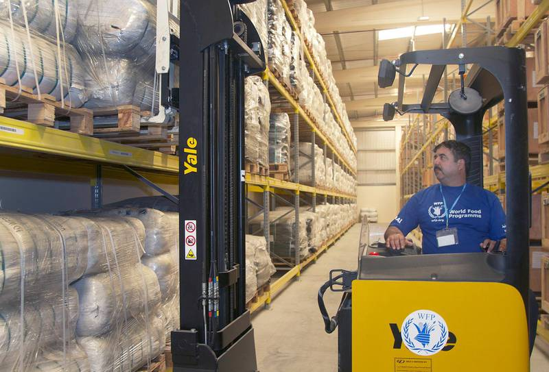 Ali Goahr, a forklift operator for the United Nations World Food Programme, moves blankets in the World Food Programme Warehouse in International Humanitarian City, Dubai, UAE Monday November 18, 2013.Similar blankets were recently shipped to the Phillipines to aid victims of Typhoon Haiyan.Credit: Kevin J. Larkin for The National