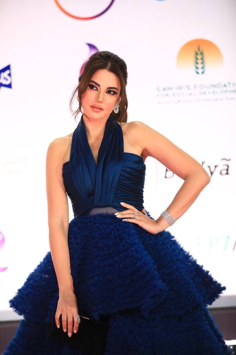 epa08858412 Egyptian Actress Dorra Zarrouk attends the opening ceremony of the 42nd Cairo International Film Festival (CIFF), in Cairo, Egypt, 02 December 2020. According to the organizers, the 42nd edition of the CIFF running from 02 to 10 December, will feature 16 titles on their international premieres in Cairo.  EPA-EFE/MAHMOUD AHMED