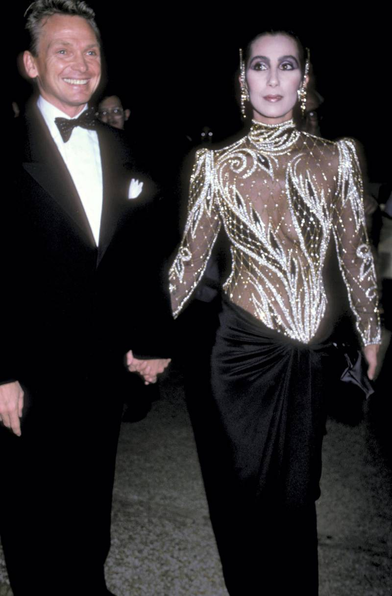 """NEW YORK CITY - DECEMBER 9:   Fashion designer Bob Mackie and singer/actress Cher attend The Metropolitan Museum's Costume Institute Gala Exhibition of """"Costumes of Royal India"""" on December 9, 1985 at The Metropolitan Museum of Art in New York City. (Photo by Ron Galella/WireImage)"""