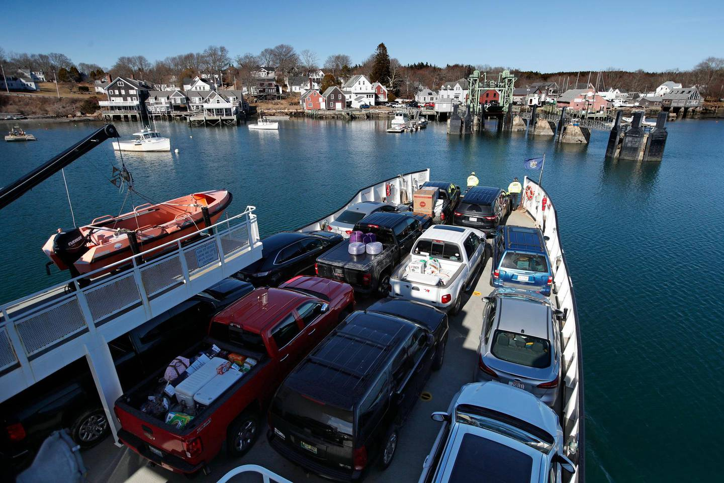 An automobile ferry arrives at North Haven, Maine, Monday, March 16, 2020. The North Haven Select Board voted to ban visitors and seasonal residents immediately to prevent the spread of the coronavirus to the island in Penobscot Bay. For most people, the new coronavirus causes only mild or moderate symptoms, such as fever and cough. For some, especially older adults and people with existing health problems, it can cause more severe illness, including pneumonia. The vast majority of people recover from the new virus. (AP Photo/Robert F. Bukaty)