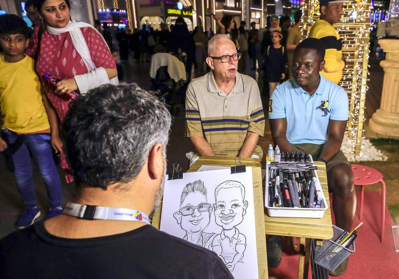 Abu Dhabi, United Arab Emirates, January 5, 2020.  --  A caricature artist at the global Village.Photo essay of Global Village.Victor Besa / The NationalSection:  WKReporter:  Katy Gillett
