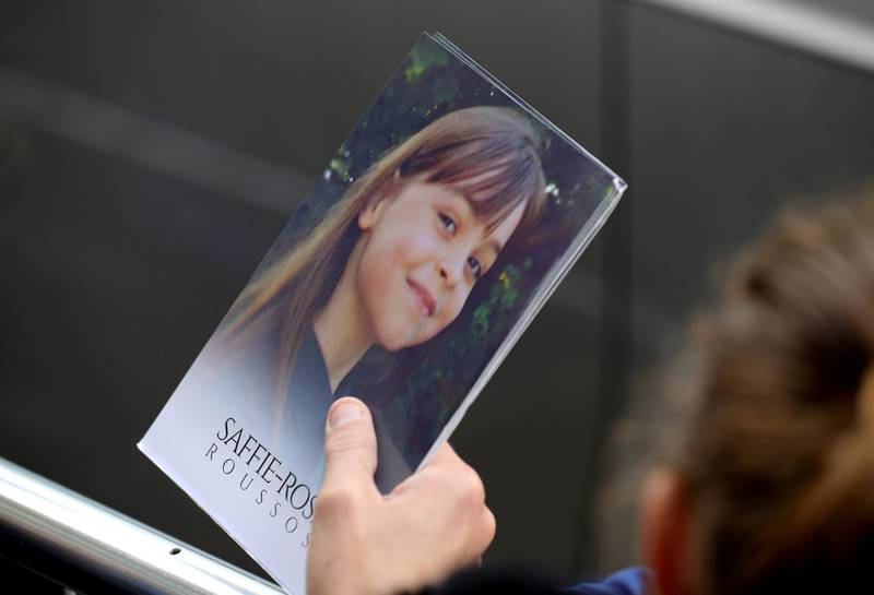 MANCHESTER, ENGLAND - JULY 26:  A man holds a thank you note from the family of Saffie Roussos to the those attending the funeral of the young Manchester Attack victim outside Manchester Cathedral on July 26, 2017 in Manchester, England. Saffie Rousso, aged eight, from Lancashire was the youngest victim of the Manchester sucide bombing attack at the Ariana Grande concert in May. The funeral of Saffie is the last of the 22 victims of the bombing.  (Photo by Christopher Furlong/Getty Images)