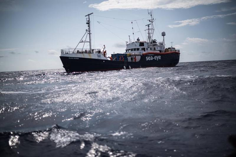 """TOPSHOT - This handout picture taken on July 5, 2019 and released on January 25, 2020 by German migrant rescue NGO Sea-Eye shows their vessel """"Alan Kurdi"""" at sea. The """"Alan Kurdi"""" brought help to 78 people spread over two boats in difficulty off the Libyan coast, the German NGO Sea Eye announced on January 25, 2020. - RESTRICTED TO EDITORIAL USE - MANDATORY CREDIT """"AFP PHOTO /SEA-EYE.ORG / Nick Jaussi"""" - NO MARKETING NO ADVERTISING CAMPAIGNS - DISTRIBUTED AS A SERVICE TO CLIENTS  / AFP / sea-eye.org / sea-eye.org / Nick Jaussi / RESTRICTED TO EDITORIAL USE - MANDATORY CREDIT """"AFP PHOTO /SEA-EYE.ORG / Nick Jaussi"""" - NO MARKETING NO ADVERTISING CAMPAIGNS - DISTRIBUTED AS A SERVICE TO CLIENTS"""