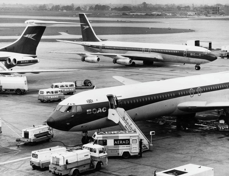 A BOAC Boeing 707 taxing to its' terminal gate as two Vickers VC10 long-range narrow-body four engined commercial jet airliners for the British Overseas Airways Corporation are refuelled at London Heathrow airport on 22 October 1968 in London, United Kingdom (Photo by Tim Graham/Fox Photos/Hulton Archive/Getty Images).
