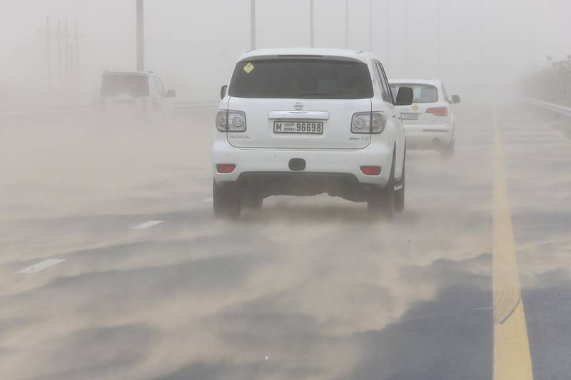 DUBAI , UNITED ARAB EMIRATES – March 20 , 2017 : Traffic during the dust storm on Al Qudra road in Dubai. ( Pawan Singh / The National ) For News / Online *** Local Caption ***  PS2003- WEATHER03.jpg