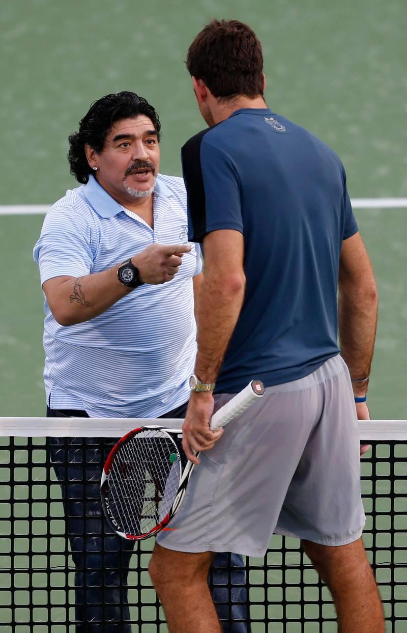 Juan Martin Del Potro of Argentina speaks to former Argentine soccer star Diego Maradona after his men's singles match against Somdev Devvarman of India during the ATP Dubai Tennis Championships, February 27, 2013. REUTERS/Mohammed Salem (UNITED ARAB EMIRATES - Tags: SPORT TENNIS ENTERTAINMENT) *** Local Caption ***  DUB13_TENNIS-MEN-DU_0227_11.JPG
