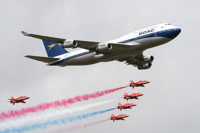 FAIRFORD, ENGLAND - JULY 20:  A British Airways special liveried Boeing 747 takes to the skies alongside the Red Arrows during the 2019 Royal International Air Tattoo on July 20, 2019 at RAF Fairford, England. The Boeing 747 has been painted in the airline's predecessor British Overseas Airways Corporation (BOAC) livery to mark British Airways' centenary this year.  (Photo by Ian Gavan/Getty Images for British Airways)