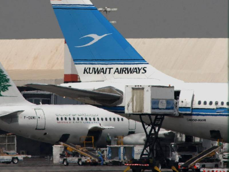 A Kuwait Airways plane at Kuwait International Airport's tarmak is seen in this file photo taken in May 2009. An Airbus 300's flight of the country's official carrier bound to Dakka had to turn back after smoke was reported in the cabin. The aircraft made an emergency landing at Kuwait Airport. Several passengers and crew were injured during the evacuation procedures.(File Photo:Gustavo Ferrari/The National)