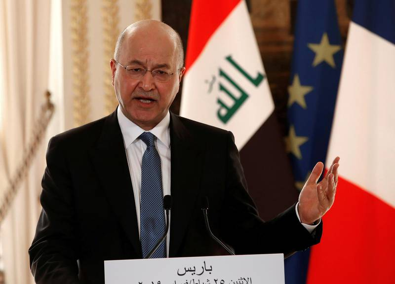 FILE PHOTO: Iraqi President Barham Salih speaks during a news conference at the Elysee Palace in Paris, France, February 25, 2019. Christophe Ena/Pool via REUTERS/File Photo