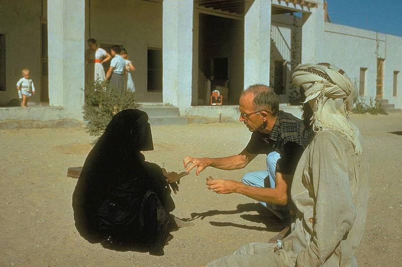 Dr Pat Kennedy treating a woman at the original hospital compound, circa 1961. This handout photograph is an archival image of the Oasis hospital Al Ain in the 1960s. Courtesy of Brooks Glett/Oasis Hospital