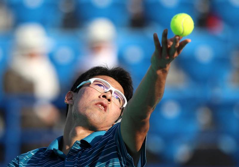 Abu Dhabi, United Arab Emirates - Reporter: Jon Turner: Hyeon Chung serves during the fifth place play-off between Andrey Rublev v Hyeon Chung at the Mubadala World Tennis Championship. Friday, December 20th, 2019. Zayed Sports City, Abu Dhabi. Chris Whiteoak / The National