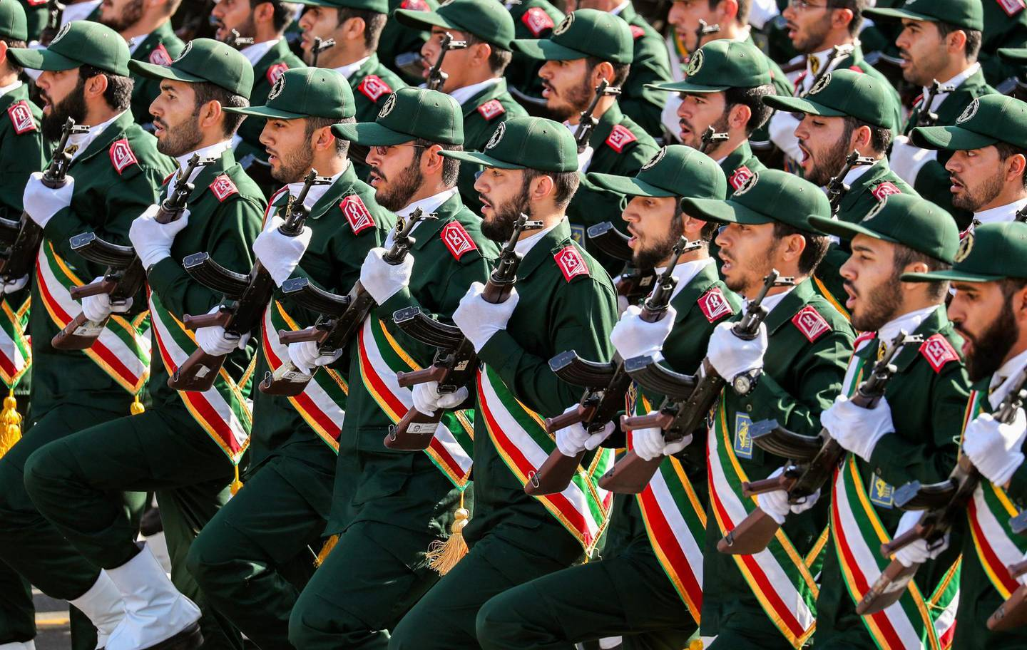 """(FILES) In this file photo taken on September 22, 2018 shows members of Iran's Revolutionary Guards Corps (IRGC) marching during the annual military parade which markins the anniversary of the outbreak of the devastating 1980-1988 war with Saddam Hussein's Iraq, in the capital Tehran. Iran's top security body called an urgent meeting on January 3, 2020 over the """"martyrdom"""" of Quds Force commander Qasem Soleimani by the United States in Baghdad, semi-official news agency ISNA reported. The United States announced earlier that it had killed the commander of the Islamic republic's Quds Force, Qasem Soleimani, in a strike on Baghdad's international airport early on Friday. / AFP / afp / STRINGER"""