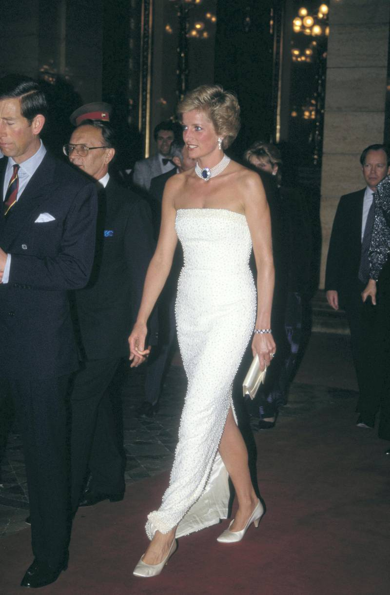Prince Charles and Diana, Princess of Wales  (1961 - 1997) attend a dinner held by Hungarian President Arpad Goncz at the parliament buildings in Budapest, Hungary, May 1990. Diana is wearing a white beaded strapless evening gown by Catherine Walker and a pearl and sapphire choker.  (Photo by Jayne Fincher/Princess Diana Archive/Getty Images)