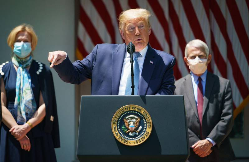 """(FILES) In this file photo taken on May 15, 2020 US President Donald Trump speaks on vaccine development in the Rose Garden of the White House in Washington, DC, flanked by White House Coronavirus Task Force Deborah Birx and Director of the National Institute of Allergy and Infectious Diseases Anthony Fauci.  Former US president Donald Trump on March 29, 2021 lashed out at two of the country's leading figures in the coronavirus battle after they criticized his handling of the pandemic. In an angry statement, Trump described Anthony Fauci and Deborah Birx as """"two self-promoters trying to reinvent history to cover for their bad instincts and faulty recommendations, which I fortunately almost always overturned."""" / AFP / MANDEL NGAN"""