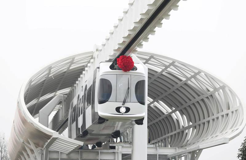 Mandatory Credit: Photo by Xinhua/Shutterstock (7450143c)A train suspended from a railway line runs in Chengdu, capital of southwest China's Sichuan ProvinceSuspension railway line, Chengdu, Sichuan Province, China - 21 Nov 2016After two months of tests, China's first suspension railway line met all designed requirements and it is ready for more systematic operations.