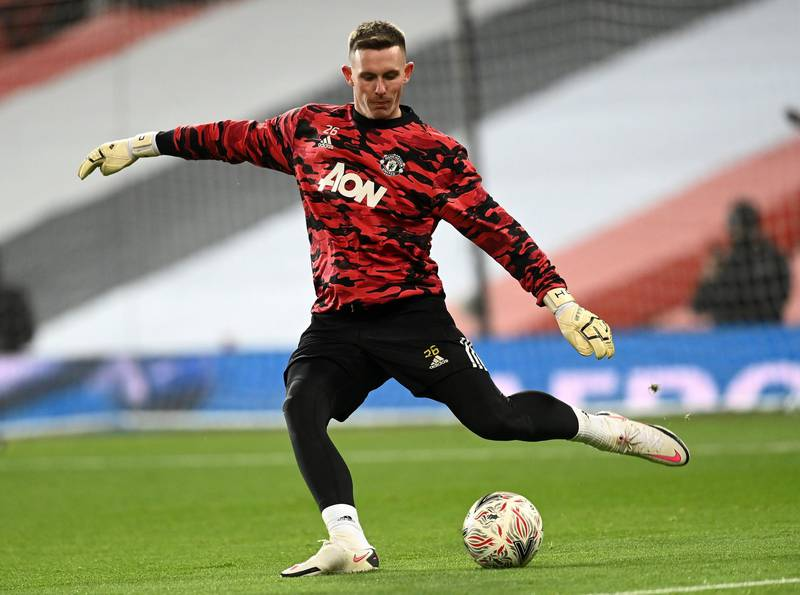 MANCHESTER, ENGLAND - FEBRUARY 09: Dean Henderson of Manchester United warms up prior to The Emirates FA Cup Fifth Round match between Manchester United and West Ham United at Old Trafford on February 09, 2021 in Manchester, England. Sporting stadiums around the UK remain under strict restrictions due to the Coronavirus Pandemic as Government social distancing laws prohibit fans inside venues resulting in games being played behind closed doors. (Photo by Michael Regan/Getty Images)